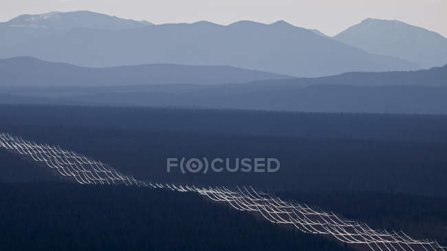 Aerial view over mountains silhouettes in South Cariboo region of British Columbia in Canada. — Stock Photo
