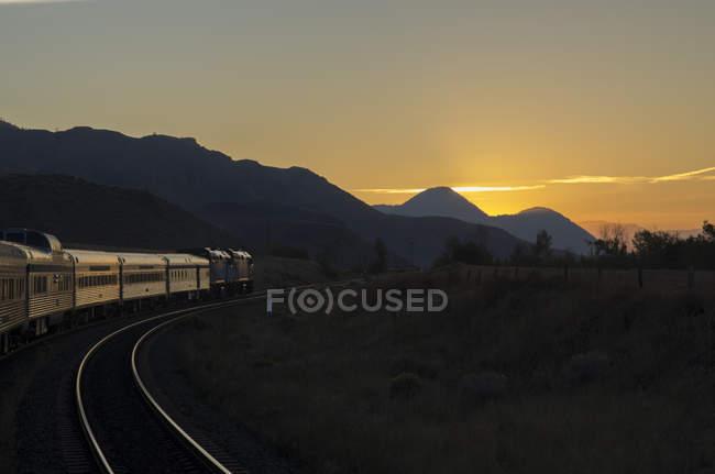 Passenger train moving at sunrise in Kamloops, British Columbia, Canada. — Stock Photo