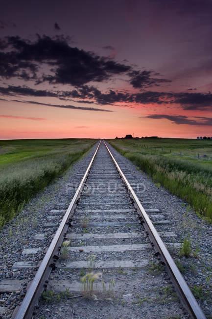 Train tracks at sunrise near Leader, Saskatchewan, Canada — Stock Photo