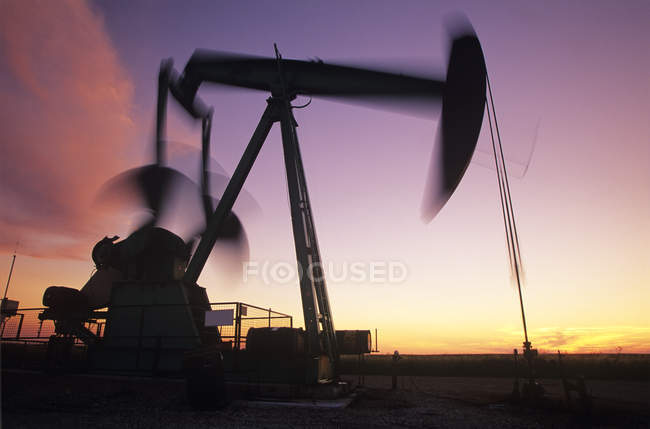 Silhouette of moving pumpjack near Carlyle, Saskatchewan, Canada. — Stock Photo
