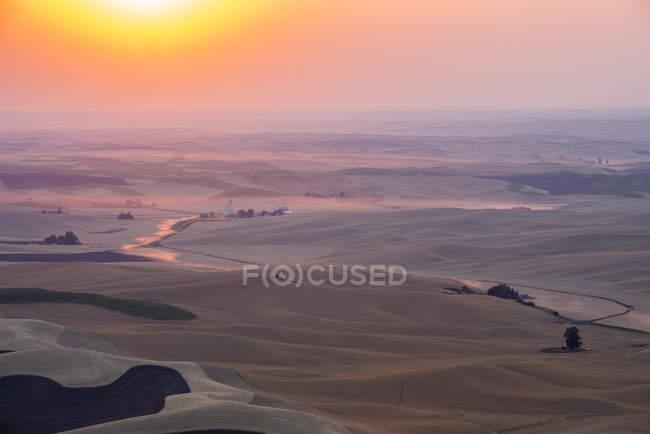 Sunset above farmland of Palouse, Washington State, USA. — Stock Photo