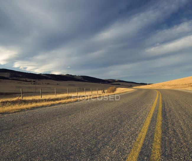 Grand Valley Road through country in Cochrane, Alberta, Canada — Stock Photo