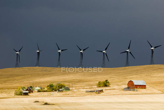 Stormy sky and turbines in countryside near Pincher Creek, Alberta, Canada — Stock Photo