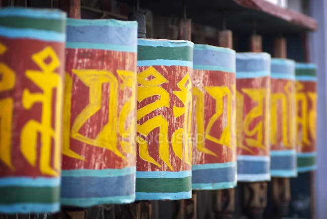 Prayer wheels along street of Paro, Bhutan. — Stock Photo