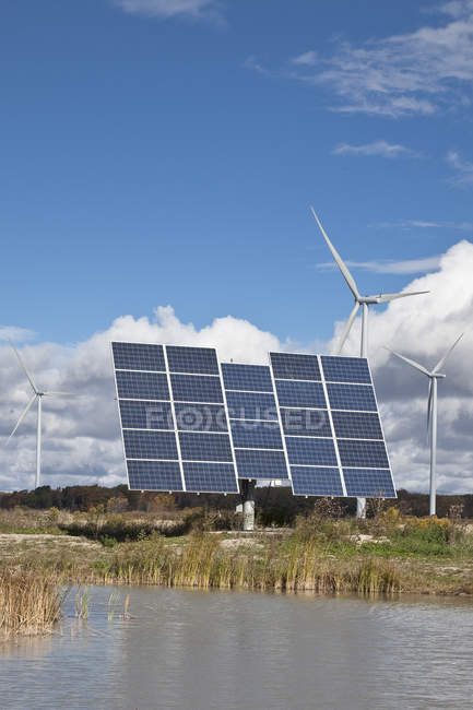 Solar panels and windmills in farmland of southwestern Ontario in Canada. — Stock Photo