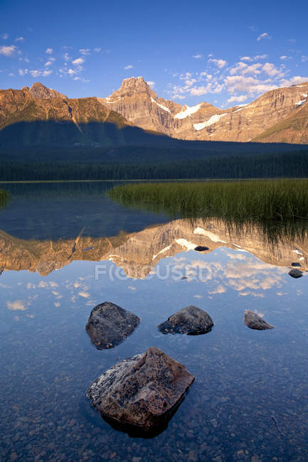 Howse Peak reflecting in rocky Upper Waterfoul Lake, Banff National Park, Alberta — Stock Photo