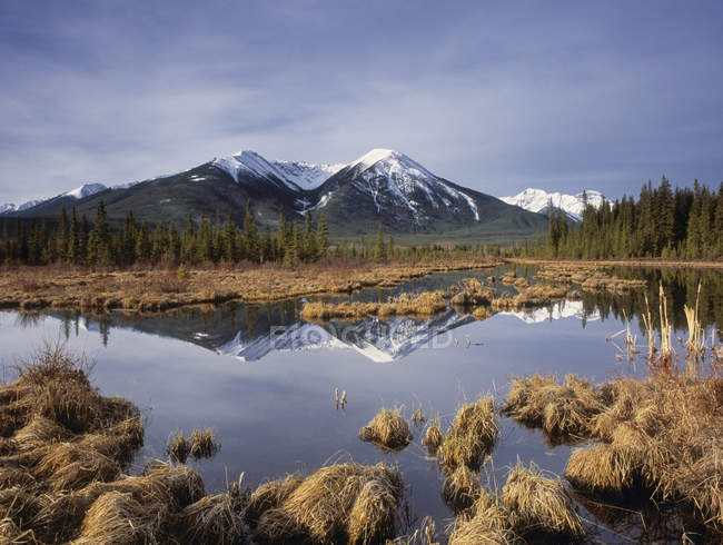 Mountains of Sundance Range reflecting in water of Third Vermilion Lake, Banff National Park, Alberta, Canada — Stock Photo
