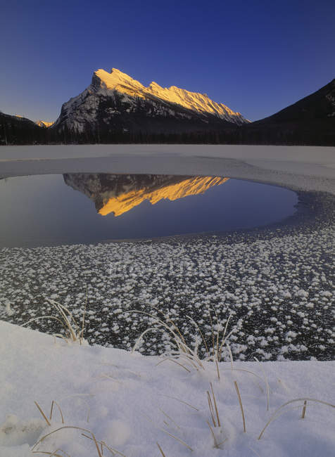 Vermilion Lakes water reflecting Mount Rundle in sunlight in winter, Banff National Park, Alberta, Canada. — Stock Photo