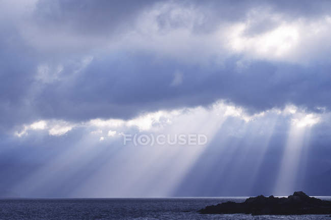 Sunshine through cloudscape above Queen Charlotte Islands, Haida Gwaii, British Columbia, Canada. — Stock Photo