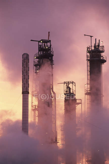 Petrochemical refinery at sunrise with towers silhouettes, British Columbia, Canada. — Stock Photo
