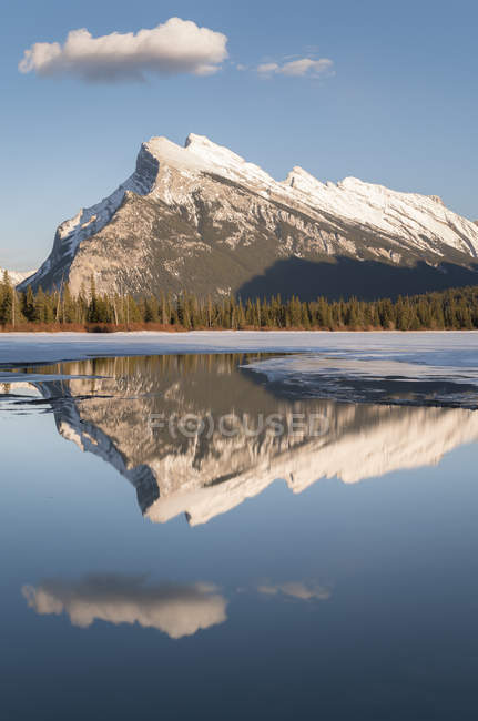 Mount Rundle reflecting in Vermilion Lake in winter in Banff National Park, Alberta, Canada. — Stock Photo