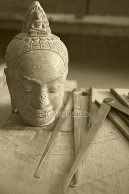 Carved Buddha head at Artisans Angkor, Siem Reap, Cambodia. — Stock Photo