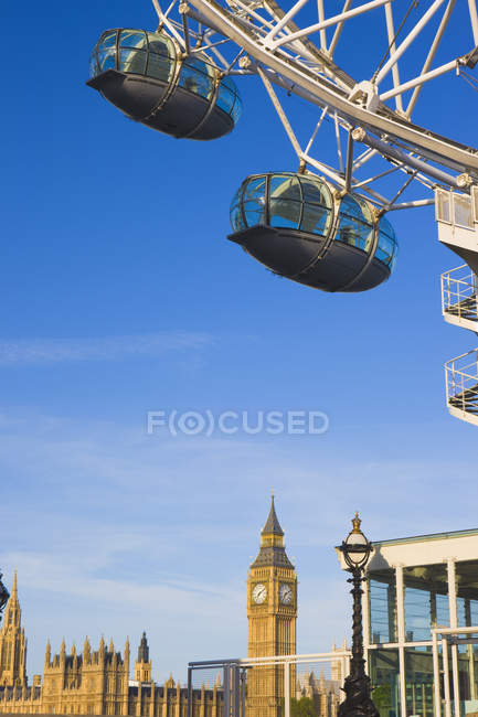 Close-up of London Eye with Big Ben in distance, London, England, United Kingdom. — Stock Photo