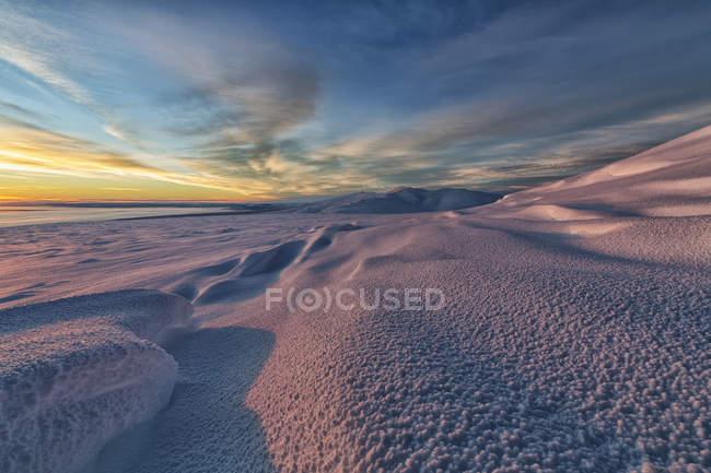 Sunlight illuminating snow covered flanks of Crow Mountain near Old Crow, Yukon. — Stock Photo
