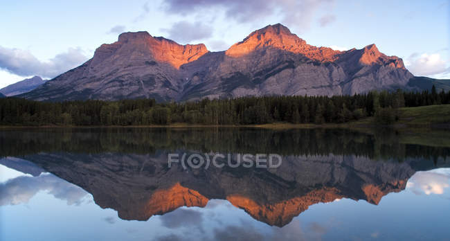 Mount Kidd reflection in Wedge Pond at sunrise, Kananaskis Country, Alberta, Canada — Stock Photo