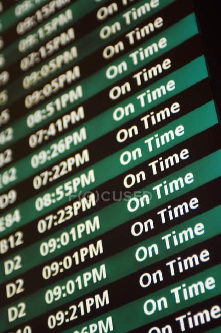 Розклад на борту виїзд в аеропорт, Закри — стокове фото
