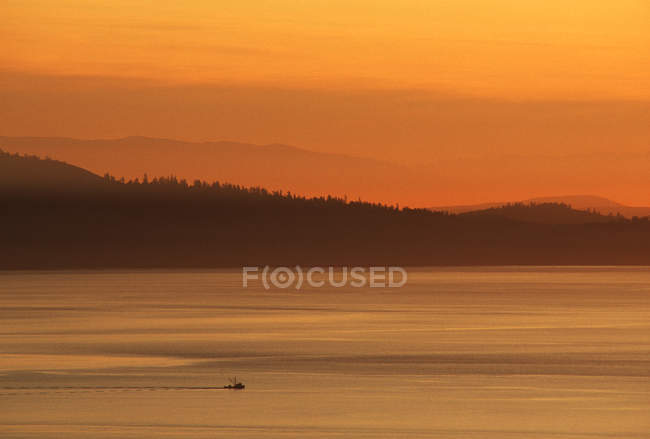 Fishing troller on Haro Strait with layered hills at Victoria, Vancouver Island, British Columbia, Canada. — Stock Photo
