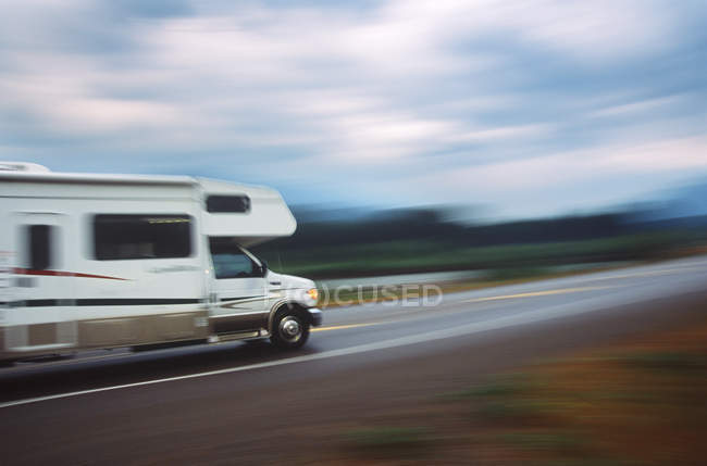 Blurred shot of motorhome on highway, British Columbia, Canada. — Stock Photo