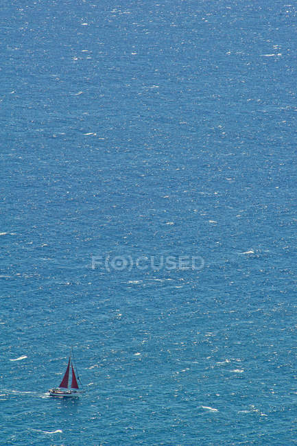 Aerial view of small yacht sailing in open ocean. — Stock Photo