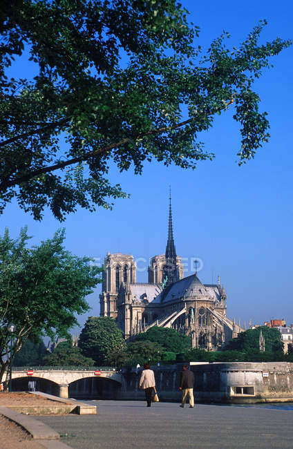 Notre Dame Cathedral along Seine river embankment in Paris, France — Stock Photo