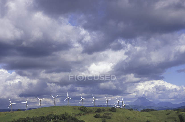 Wind turbines in hills above Lake Arenal of Guancaste Province in Costa Rica — Stock Photo