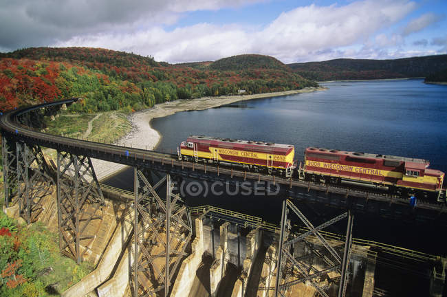 Aerial view of train riding on bridge at Agawa Canyon Wilderness Park, Ontario, Canada. — Stock Photo