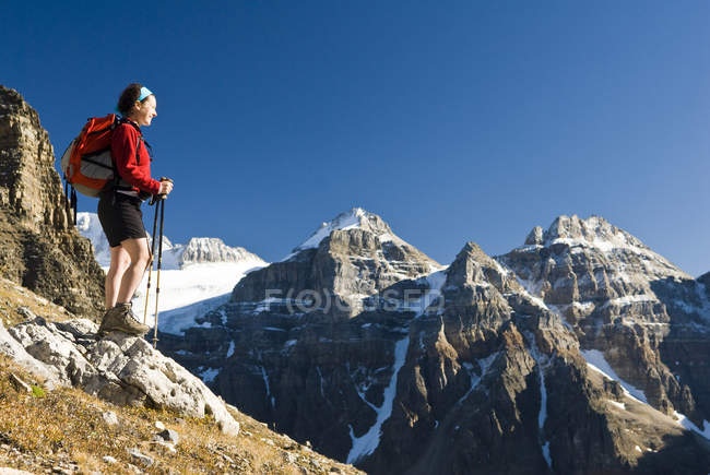 Female hiker above Moraine Lake and Valley of the Ten Peaks at trail to Sentinel Pass, Alberta, Canada. — Stock Photo