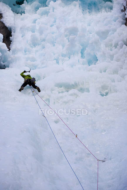 Male ice climber moving up mountain at Ghost River, Alberta, Canada — Stock Photo