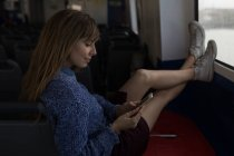 Beautiful woman using mobile phone in cruise ship — Stock Photo