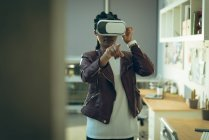 Executive using virtual reality headset in office — Stock Photo