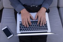 Mid section of businessman using a laptop — Stock Photo