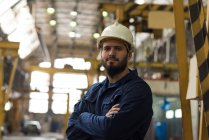 Portrait of confident technician standing with arms crossed in metal industry — Stock Photo
