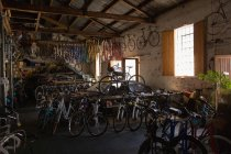 Various bicycles in workshop — Stock Photo