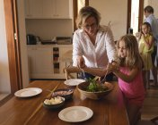 Family having lunch in kitchen at home — Stock Photo