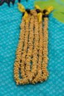 Close-up of lei garland arranged on a mat — Stock Photo
