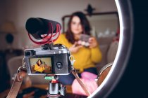 Female video blogger recording video vlog at home — Stock Photo