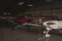Two manufactured aircrafts parked in aerospace hangar — Stock Photo