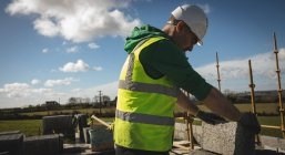 Engineer holding cement slab at construction site — Stock Photo