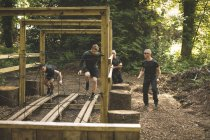 Group of men's training on obstacle course at boot camp training — Stock Photo