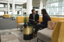 Business people discussing in the lobby in office — Stock Photo