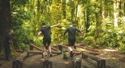 Fit men training over obstacle course at boot camp — Stock Photo