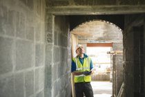 Engineer looking at the doorway at construction site — Stock Photo