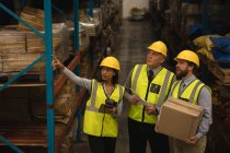 Staff interacting with each other in warehouse — Stock Photo