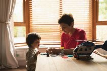 Mother playing with son on the table at home — Stock Photo
