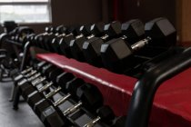 Close-up of dumbbells arranged in the gym — Stock Photo