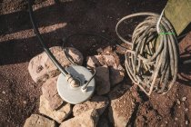 Water pump in the dirt on construction site — Stock Photo