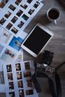 Overhead view of digital tablet, camera and documents on a table — Stock Photo