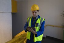 Male worker using digital tablet at solar station office — Stock Photo