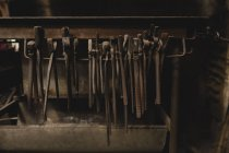 Various pliers hanging in workshop — Stock Photo
