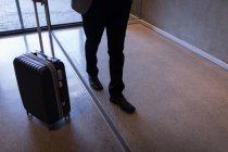 Low section of businessman walking into the hotel — Stock Photo